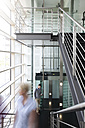 Business people at elevator in office building - KFF000174