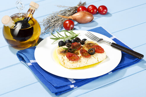 Feta, tomatoes, olives and rosemary in plate with fork - MAEF007019