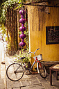 Vietnam, Hoi An, Bicycle in front of restaurant - MBE000627