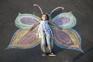 Little girl lying on street painting - SARF000082