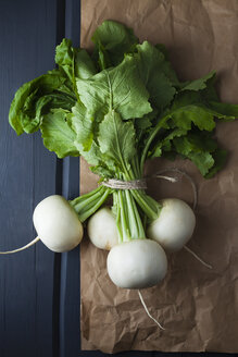 Turnips on brown paper, close up - ECF000278