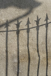 Germany, Shadow of fence on wall - LB000200