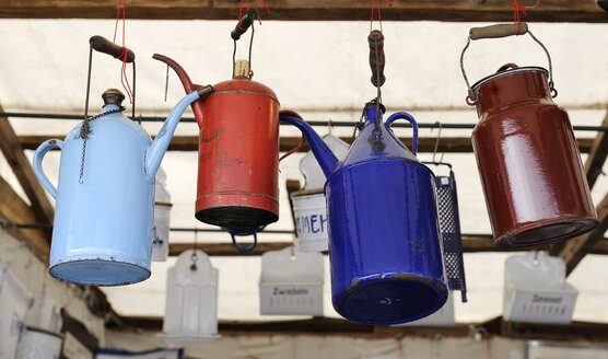 Germany, Bavaria, Munich, Old cans hanging  in Auer Dult market - LH000250