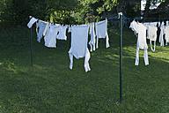 Germany, Bavaria, Munich, Clothes hanging on washing line - TCF003521