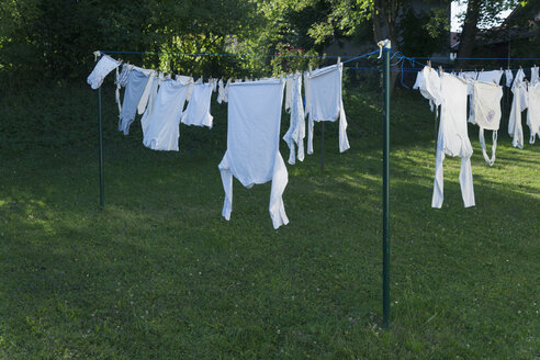 Germany, Bavaria, Munich, Clothes hanging on washing line - TCF003521