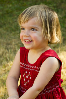 Germany, Baden Wuerttemberg, Girl looking up, smiling, close up - LVF000189