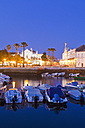 Portugal, Faro, Boats in harbour, old town in background - WDF001817