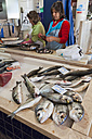 Portugal, Lagos, Fishmonger working in market hall - WD001786