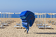 Portugal, Albufeira, Preparing beach loungers in morning - WD001760