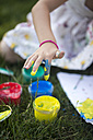 Germany, Bavaria, Girl hand with finger paint, close up - SARF000090
