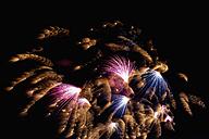 Germany, North Rhine Westphalia, Duesseldorf, Fireworks exploding in sky - KJF000245