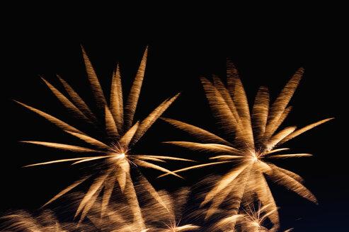 Germany, North Rhine Westphalia, Duesseldorf, Fireworks exploding in sky - KJF000240