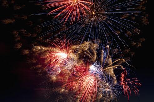 Germany, North Rhine Westphalia, Duesseldorf, Fireworks exploding in sky - KJF000238