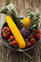 Bowl of vegetables on wooden table, close up - OD000276