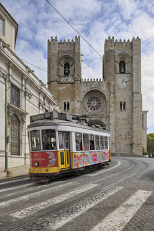 Portugal, Lisbon, Tramway passing through Patriarchal Cathedral of St Mary Major - RUE001123