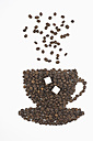 Coffee beans in shape of coffee cup with sugar on white background - ASF005070