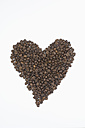 Coffee beans forming heart on white background - ASF005067