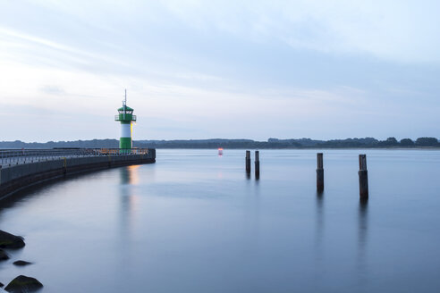 Germany, Lubeck, View of lighthouse on jetty - NKF000003