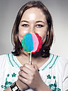 Portrait of Young woman holding lollipop, close up - STKF000307