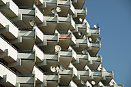 Germany, North Rhine Westphalia, Cologne Chorweiler, part of high-rise apartment building with balconies and satellite dishes - WG000009