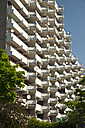Germany, North Rhine Westphalia, Cologne Chorweiler, High-rise apartment building with balconies and satellite dishes - WG000008