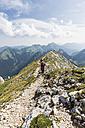 Germany, Bavaria, Ammergau Alps, View of hiker on ridge walk to Ammergauer Hochplatte - FO005149