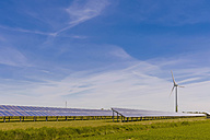 Germany, Schleswig-Holstein, View of solar panel and wind turbine in field - MJF000325