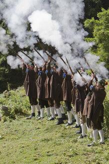 Germany, Bavaria, Men firing at Annafest festival - FF001361