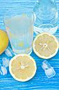 Germany, Baden Wuerttemberg, Lemonade juice on wooden table, close up - LVF000192