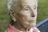 Germany, North Rhine Westphalia, Cologne, Senior woman sitting on bench - JAT000204