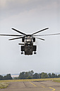Germany, Baden Wuerttemberg, Laupheim. View of CH-53 helicopter flying - HA000218