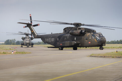 Germany, Baden Wuerttemberg, Laupheim. View of CH-53 helicopter taxiing to parking position - HA000215