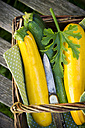 Studio, Zucchini in basket on wooden table, close up - LV000193