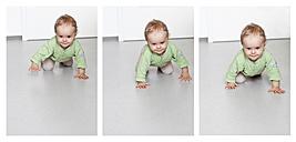 Germany, Kiel, baby girl crawling - JFE000164