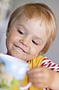 Germany, Kiel, child with cup, portrait - JFEF000188