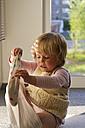 Germany, Rostock, little girl attracting herself - JFEF000178