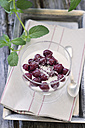 Rice pudding with cherries in tray on table - ODF000305