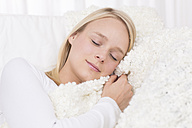 Young woman sleeping on couch - DRF000125
