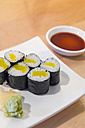 Sushi rolls with picked radish in rice on plate, close up - ABAF000990