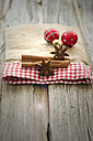 Christmas baubles with star anise and cinnamon on wooden table, close up - OD000318