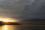 Canada, British Columbia, Vancouver, Lions Gate Bridge and Stanley Park at sunset - FO005191