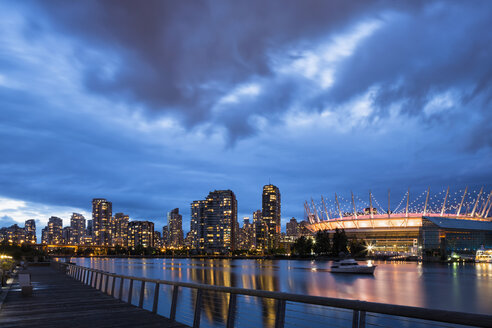 Canada, Skyline of Vancouver at night with BC Place Stadium - FOF005180