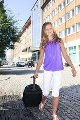 Germany, Girl holding luggage - VTF000014