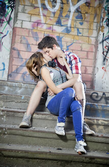 Germany, Berlin, Teenage couple kissing each other - MVC000002