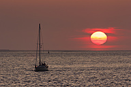 Germany, Bremerhaven, View of boat at sunset - SJ000053