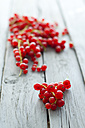 Red currants on wooden table, close up - ODF000362