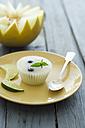 Honeydew melon with honeydew melon ice on plate, close up - ODF000366