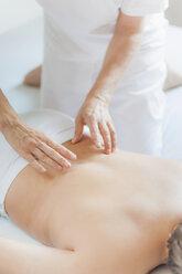 Traditional Chinese Medicine, TCM, female therapist during Tuina massage - MJF000371