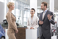 At the car dealer, Salesman talking to client - MLF000097