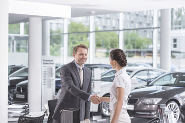 At the car dealer, Salesman and client shaking hands - MLF000027